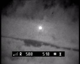 Photo: Бинокль БПЦс10х40 установлен в поле на треноге на расстоянии 500-510 м.