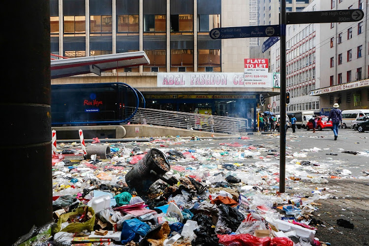 Pikitup employees affiliated to the South African Municipal Workers' Union embarked on an unprotected strike and trashed the streets, thought Johannesburg CBD. Picture: THE TIMES/MOELETSI MABE
