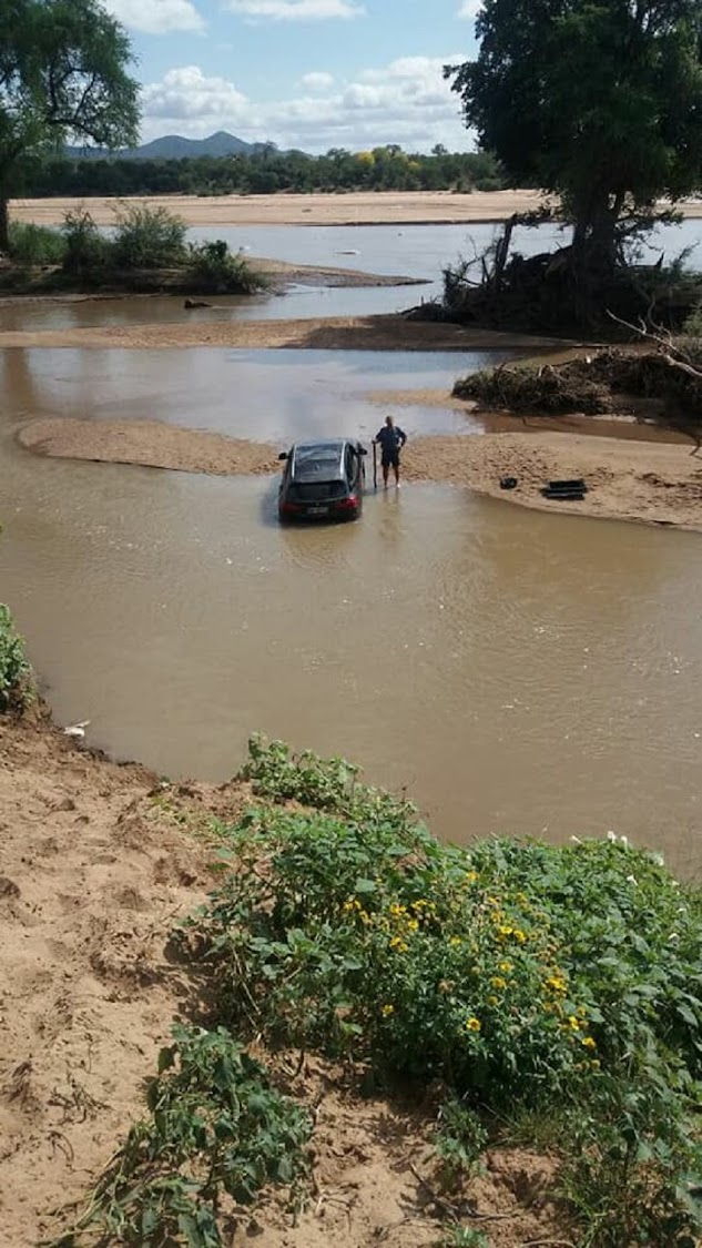 Police prevent stolen cars crossing river at border into Zimbabwe.