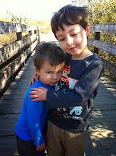 Photo: Brothers Hug on Bridge