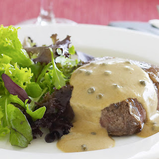 Ribeye Steaks with Creamy Peppercorn Sauce.