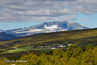 Photo: Hjerkinn Fjellstue (mountain lodge) with Snøhetta in the background (which is the highest mountain in the Dovre mountains, and the highest in Norway outside Jotunheimen).