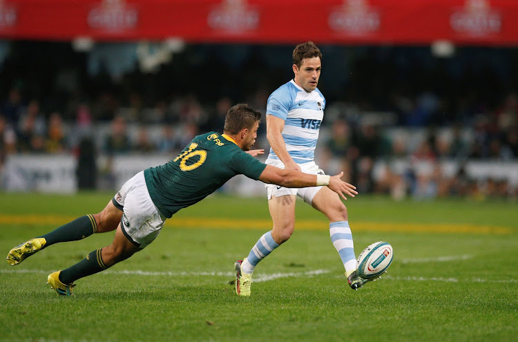 Argentina's Nicolas Sanchez kicks under pressure from South Africa's Handre Pollard during the Rugby Championship match at Kings Park Stadium in Durban on August 18, 2018.