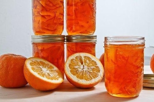 When marmalade reaches the jelly stage, carefully ladle into the prepared jelly glasses. Put...