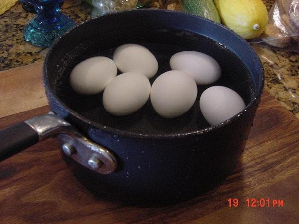 BOIL THE EGGS:  Bring a pan of room temperature eggs and 1 tablespoon of white...