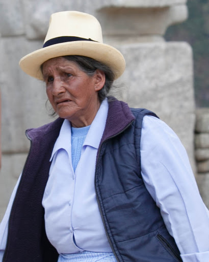 A Peruvian woman in traditional garb at Machu Picchu.