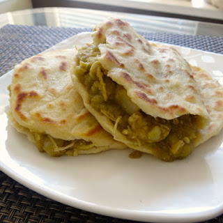 Flour Gorditas with Chicken, Potato, and Green Chile Stew.