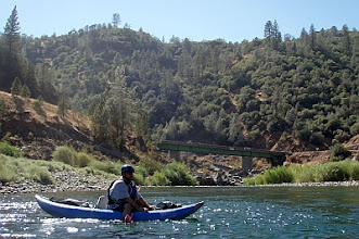 Photo: Dustin kayaking upstream from the Hwy49 bridge.