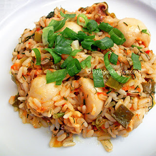 Delicious Cuttlefish With Rice And Spring Onions.