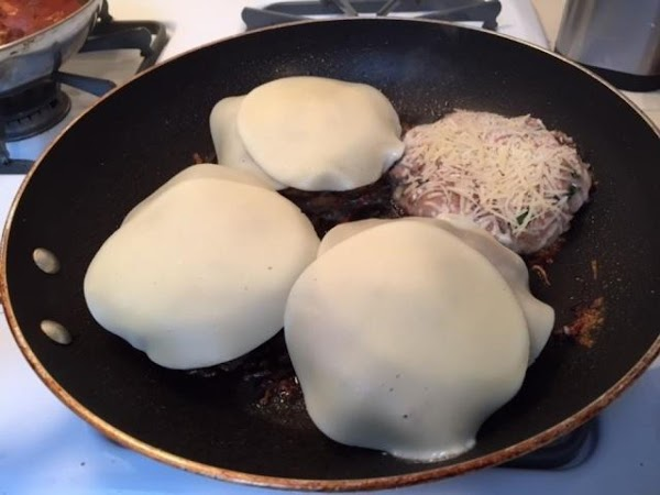 Reduce heat add 2 slices of cheese to each burger and cover for 2...
