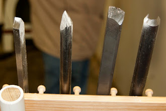 "Photo: Marks weapons of choice: a parting/beading tool, a detail gouge, a skew, and his signature 5/8"" spindle roughing gouge made for him by Doug Thompson."