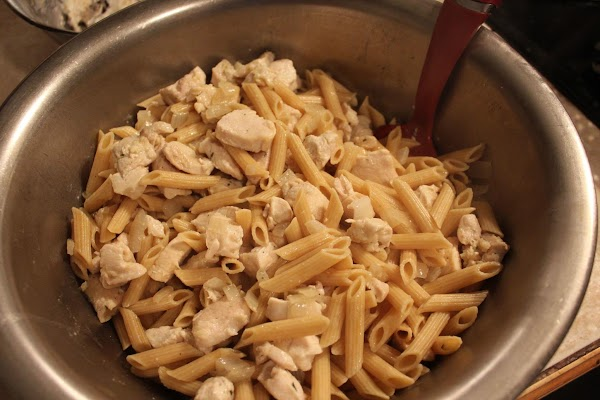 In large mixing bowl, mix pasta, chicken and onions.
