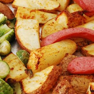 Smoked Sausage Sheet Pan Dinner with Seasoned Potato Wedges.