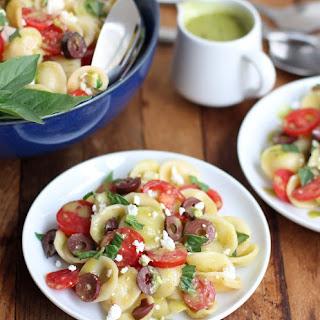 Pasta Salad with Feta, Tomato, Kalamata Olives and Sweet Basil Vinaigrette.