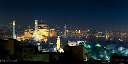Photo: Hagia Sophia by night Istanbul, Turkey From the blog http://www.kylefoto.com  The Hagia Sophia (or ayasofya) is a place so rich in history I can merely scratch the surface of this ancient centre of religiosity. Originally conceived as a greek cathedral of constantinople in 360AD this monolith has shifted theological allegiances numerous times, lastly becoming a mosque in 1453 which was finally converted to a museum in 1931.  One of the coolest things about the building is it's restoration, and with it's long history of being both a church and a mosque a careful extraction of the newer islamic art reveals the ancient christian mosaics behind them. The resulting experience is a beautiful mix of both cultures in one breathtaking monument to architecture and history.  Photographic details: This building being the largest cathedral in the world for nearly a thousand years is certainly deserving to look as grand as possible. Believe it or not once you get close to this building, most of it's minarets, great architecture, and city behind it is blocked by it's surrounding buildings. I really wanted to show the context of this building as it stood the test of time in the ever changing city landscape around it.  I decided to climb the roof of some hotels nearby to get a view of the city lights. With a tripod I shot a 2 second exposure at 70mm to zoom in enough to get details, while also keeping enough foreground and background. This is another great example of landscape shots being taken with a telephoto lens.  2s f/3.5 ISO100 70mm