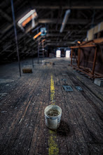 Photo: Grab the mop 'n bucket  I decided to reprocess an oldie but goodie from 2010 and change things up with a grungy UrbEx scene. I nabbed this shot on my first visit to this mill with my friend back east, +Bob Lussier. I do miss my outings with him very much.  The important lesson about this point is that it's ok to interact with your environment to make your shot. Originally, this image was framed without the bucket. As I looked through the viewfinder, I liked the overall composition but it was missing a focal point. I needed and anchor for your eye to start and end at. I saw a bucket behind me, arranged it as you see it, and took the shot. In my opinion, the bucket is what makes the shot mine.  I know photographers who have this odd code where they won't allow themselves to interact with their environment. Outside of photojournalism, I'm not sure why that invisible deterrent should be placed on oneself. It's akin to photographers who feel that the only worthy photo is the one that is SOOC (Straight Out Of Camera). The bottom line is that you're the photographer creating your photo. If you're not journaling an event or being paid by someone else for that particular image, do whatever you want to make it yours.  Google Maps Location Info 42.70707, -71.15262  In terms of processing This is a mildly tone-mapped HDR image using nine brackets and Photomatix Pro.  Stylization was done in Perfect Effects 4 by +onOne Software. I combined a Soft Light blend of Blue Dawn and a touch of Urban Sickness to give it that blue/green cross processed look. I also masked in some Tonal Contrast on the floor.  Final touches were applied in Lightroom 4.3.  #blog