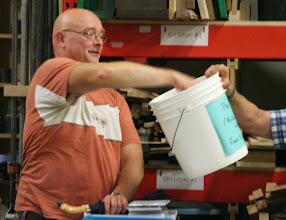 Photo: A big event of the evening was the sale of several of MCW's excess lathes at a good price.  A raffle was conducted to determine the order of selection.  Don drew names out of the bucket...