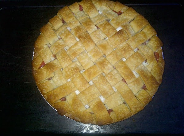 place pie on the lowest rack in the oven. Bake for 15 mins.   Reduce...