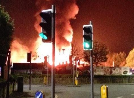 Owners suspect arson in carpet warehouse blaze