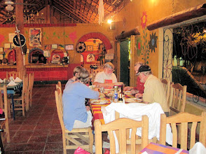 Photo: Dinner in Loreto. Diners are intent on their food.