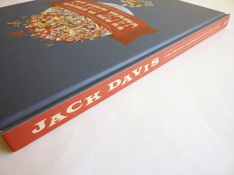 "Photo: Jack Davis: Drawing American Pop Culture - A Career Retrospective by Jack Davis  http://www.fantagraphics.com/artofjackdavis  208-page full-color 10.25"" x 13.25"" hardcover • $49.99 ISBN: 978-1-60699-447-4 - Spine."