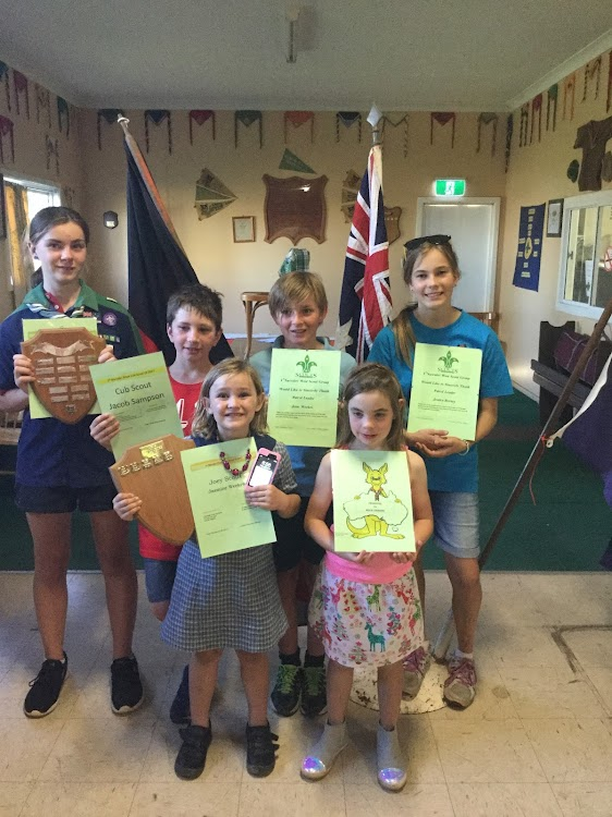 Back, Scout of the Year, Jazlyn Simshauser, Cub Scout of the Year Jacob Sampson, Patrol Leaders' Commendation Jesse Weekes and Jessica Berney, front, Joey Scout of the Year Jasmine Weekes and runner-up Millie Crossing.