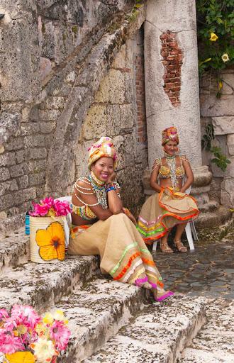 Cuban-Women-in-Dresses-with-Flowers2.jpg - Cuban women selling flower blossoms in Old Havana.