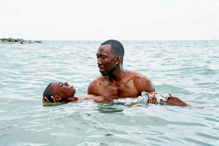 Mahershala Ali and Alex R Hibbert in Moonlight