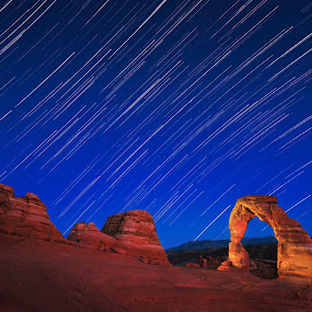 Arch Night by Qing Zhu - Landscapes Starscapes ( night vision, earth spin, arch, colorful, majestic, cliff, stone, astrronomy, landscape, nightscape, milky way, nature, utah, night, astrophotography, star trails, light, delicate arch, starscape )
