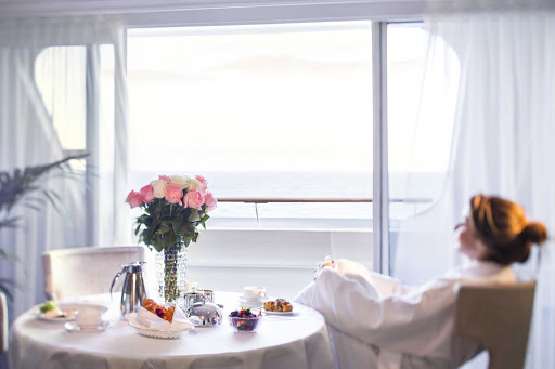 Wake up in a new port and order room service (it's complimentary) on Oceania's Sirena.