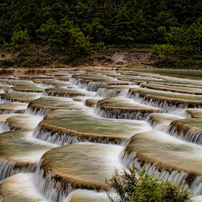 Step Waterfall by James Wheeler - Landscapes Travel ( water, stream, jade dragon snow mountain, park, flowing, silky water, waterfall, tranquil scene, scenics, yulong mountain, blurred motion, beauty in nature, steps, landscape, liquid, nature, falls, staircase, long exposure, river )