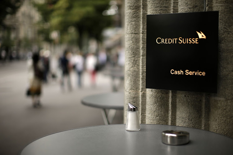 A Credit Suisse cash services sign placed at a cafe outside a Credit Suisse bank branch in Zurich, Switzerland. Picture: BLOOMBERG