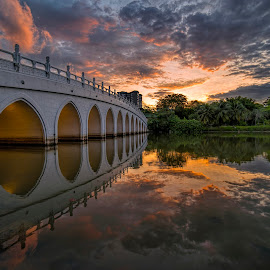 by Gordon Koh - Buildings & Architecture Bridges & Suspended Structures ( clouds, reflection, sunset, asia, lake, travel, bridge )