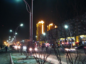 Photo: the tallest building built by QRRS, benzrad 朱子卓's long time employer and a SOE, lightened up by profile sketching lamps in eastern Qiqihar in dusk. lunar Spring festival atmosphere brewing among leisure seeking Chinese. 二十年来最暖的冬季:齐齐哈尔城东最高楼,中国北车齐轨公司巨作,临近农历2012年春节被轮廓灯装饰一新。