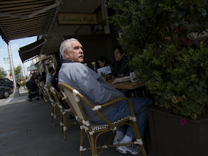 Photo: Requirement 3:  Both the backlight and the keylight came from the sun. I enjoy this shot because the shadows provide very diffuse lighting, while the sun itself highlights the man's face.  Also, the chairs provided a sense of pattern. I think the photo worked better because the other people's faces were darkened in comparison. It is clear that the old man is the subject here.