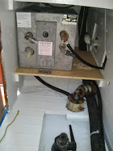 Photo: test fitting hot water heater on new shelf and primary bilge pump below