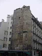 Photo: A bit farther down, at the corner of Rue Sainte-Paul and Rue Neuve-Saint-Pierre, is this towering structure – the remains of the bell tower of the medieval church St-Paul-des-Champs, where French royalty were baptized from 1361 to 1559. As is often the case, these old structures were incorporated directly into more modern buildings.