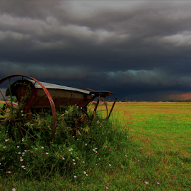 Retired by Jennifer Ablicki - Artistic Objects Antiques ( sky, seeder, storm, field, farm, antique )