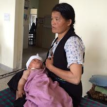 Photo: Madre con niño hospitalizado.