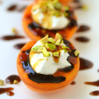Blackened Apricots with Creme Fraiche, Pistachios and Pomegranate Molasses.