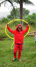 Photo: They had never seen hula hoops. They were to keep them entertained while everyone arrived.