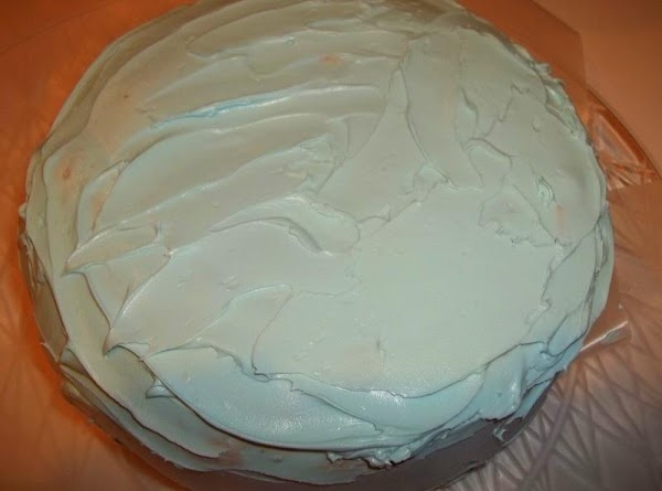 Spread a second layer of frosting, this time over the entire cake. Try to...