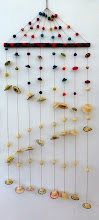 Photo: A wall hanging with miniature hats