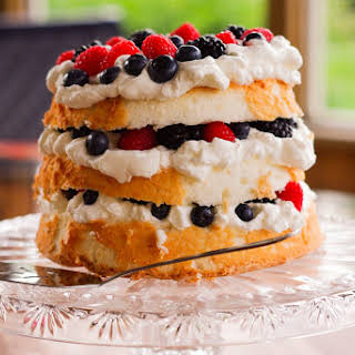 Angel Food Cake with Berries & Amaretto Whipped Cream.