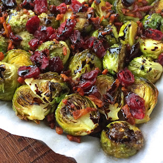 Roasted Brussels Sprouts with Cranberries, Bacon & Balsamic Reduction.