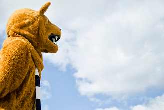 Photo: The Nittany Lion stands outside the MorningStar Solar Home at Penn State's University Park campus.