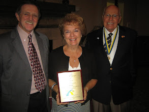 "Photo: Frank Dragoun received the ""John Carpenter Award"" for superior service to our club and to Rotary. Accepting the award for Frank was his wife Boo."