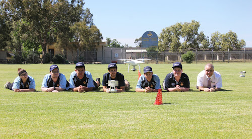 EYES ON THE PRIZE: Narrabri High School Year 11 students at a drone training session on the school oval yesterday. Pictured are Kayla Baker, Will Lonergan, Zaine Saunders, instructor Manny Tishlakis, Tyrone Hensley, Callum Campbell and relieving principal Dinos Charalambous.
