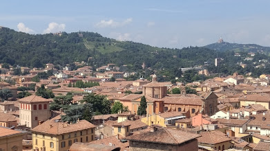 Photo: On our last day in Bologna, Chris and I finally made it to the rooftop of the Basilica of San Petronio, the largest church in Bologna, which sits on Piazza Maggiore. This is a panoramic view of the hills behind Bologna with San Luca in the upper right.