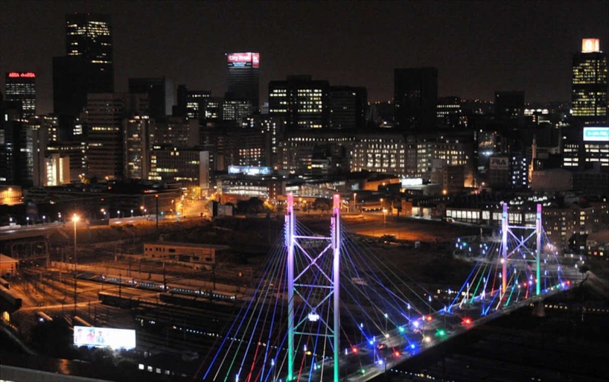 Joburg city manager and accomplice arrested on fraud charges johannesburg skyline at night thecheapjerseys Choice Image